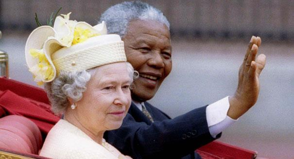 Mandela and Queen Elizabeth ride in a carriage outside Buckingham Palace on the first day of a state visit to Britain, 9 July 1996